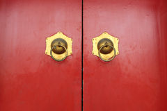 Red door and door knockers Royalty Free Stock Photo