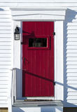 Red door in entryway Stock Photography