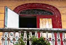 Red Door, French Quarter, Panama City. The weathered, colorful detail of an open door on the balcony of a building in Casco Viejo, the historic old french Stock Photography