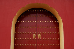 Red door with golden lion handle. An ancient Asian door with a pair of golden lion handles royalty free stock photos