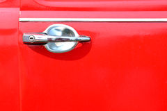 Red door handle car. Royalty Free Stock Image