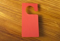Red door hanger. On a wooden background Stock Photos