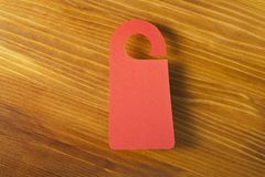 Red door hanger. On a wooden background Stock Image
