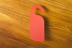 Red door hanger. On a wooden background Stock Photography