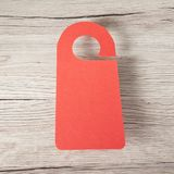 Red door hanger. On a wooden background Stock Photo
