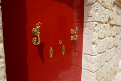 The red door of house at Mdina town Royalty Free Stock Images