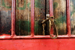 Red door. At the house with rope Royalty Free Stock Images