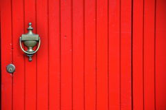 Red door in Italy. Red wooden door with brass knocker in Florence city, Italy . vintage style door Stock Photography