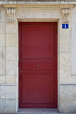 Red door in Le Marais area of Paris, France. Stock Photos
