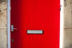 Red door with a letter slot Stock Photos