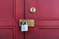 Red door with lock Royalty Free Stock Photography