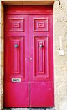 Red door in Malta. Red door on the street in Mdina, Malta Stock Images