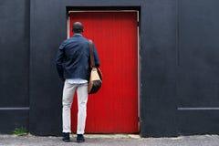 Red door man Royalty Free Stock Image