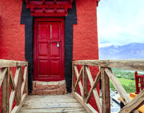 Red door at a monastery. Bridge and a door in a Buddhist monastery in Ladakh, Kashmir, India Stock Images