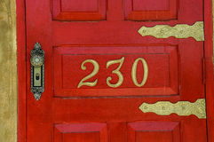 Red door number 230 Stock Images
