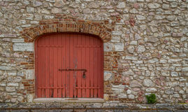 Red door of an old barn. Old renovated barn that used to store salt at the salt lakes in Lefkimmi Corfu Greece Royalty Free Stock Photo