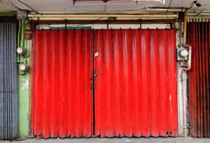 The red door of old house at Quezon city in Manila, Philippines Stock Photo