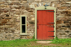 Red Door On A Old Stone Building Stock Photos