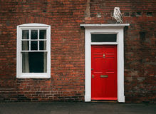 Red Door and owl Stock Image