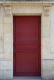 Red door in a Paris residential area Royalty Free Stock Image