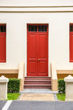 Red Door , red window on Cream Wall on red staircase with small Stock Photos