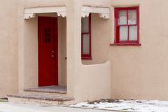 Red Door and Red Window Frames in Downtown Santa Fe, New Mexico Stock Photos