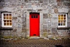 Red Door Stone House Stock Photos