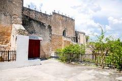 Red door in stone wall stock photos