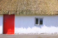 Red Door Thatched Straw Roof in Scotland Royalty Free Stock Photo