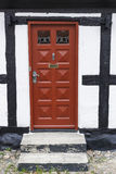 Red door to a house Stock Images