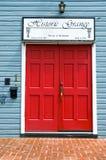 Red Door to an old Historic Grange Hall. Double door entrance to a historic grange hall through a red door Stock Photos