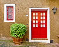 Red door_1. Red door in tuscany country Stock Photo