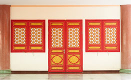 A Red Door and Two Red Window Royalty Free Stock Photo