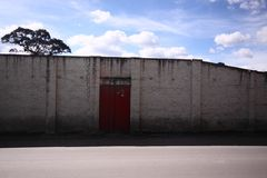 Red door in white old wall Royalty Free Stock Photography