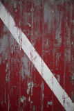 Red door with white stripe Stock Photos