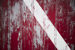 Red door with white stripe Royalty Free Stock Photo