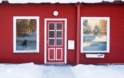 Red door in wintertime Stock Photo