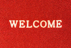 Red doormat and welcome text Stock Image