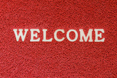 Red doormat with welcome word Stock Photo
