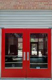 Red Doors. Red trimmed glass doors of empty office lobby Royalty Free Stock Photography