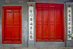 Red Doors. Two bright red doors with Chinese calligraphy o white background Stock Photos