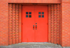 Red doors brick wall Stock Images