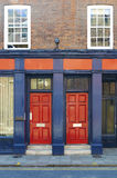 Red doors on building Stock Photos