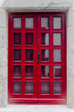 Red doors with glass windows Royalty Free Stock Photo