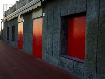 Red doors in Harbour during sunset stock photo