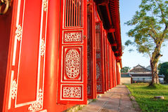 Red doors of imperial citadel, Hue, Vietnam. Historic building, Built from 1804. Is a walled fortress and palace in the city of Hue. Is situated  on the northern Stock Image