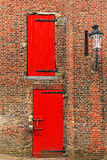Red doors Stock Images