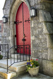 Red doors, stone facade and black ironwork, Keene, New Hampshire Stock Photo