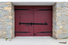 Red Doors in Stone Wall Royalty Free Stock Photos