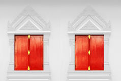 Red doors, white walls at Buddhist temple Royalty Free Stock Photo